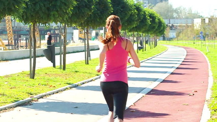 Young woman jogging. slow motion.