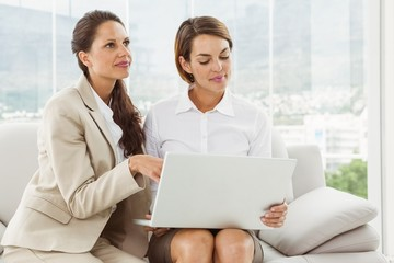Young businesswomen using laptop