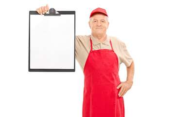 Mature market vendor holding a clipboard