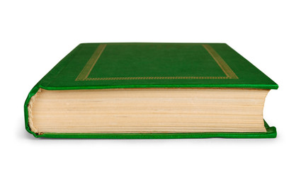 closed book in green cover to the side on an isolated white back