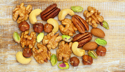 Selection of nuts on rustic wooden surface