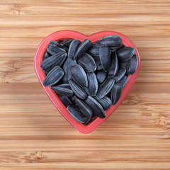 Sunflower seed in a heart bowl