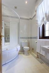 Interior of a luxury bathroom with jacuzzi bath