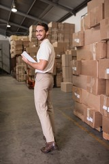 Portrait of warehouse worker with clipboard