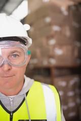 Worker wearing hard hat in warehouse