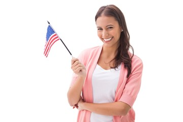 Pretty brunette smiling and holding american flag