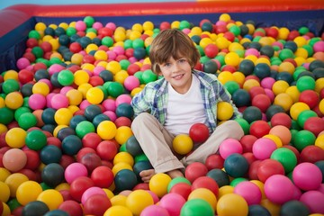 Cute boy smiling in ball pool