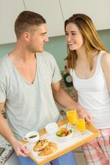 Cute couple preparing their breakfast
