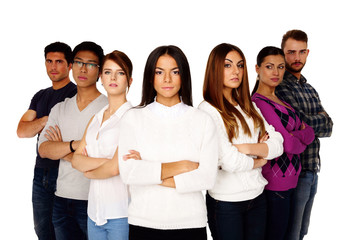 Casual group of young serious people isolated on a white