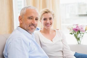 Happy couple chatting on sofa