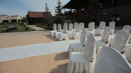 Decorating of wedding ceremony outdoors in the restaurant
