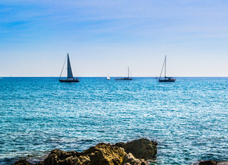 Sailboats under the sun under the sun