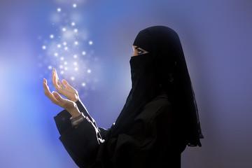 Ramadan: Beautiful young muslim girl praying, spirituality