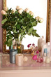 canvas print picture - Beautiful vase with roses near mirror