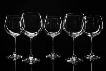 Empty wine glasses isolated on black