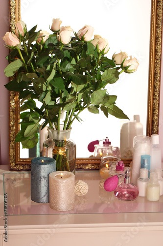canvas print picture Beautiful vase with roses near mirror