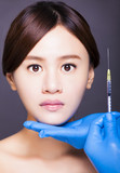 asian beautiful woman gets injection in her face. aesthetic medi poster