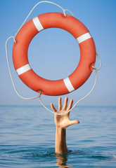 Help concept. Lifebuoy for drowning man's hand in open sea or