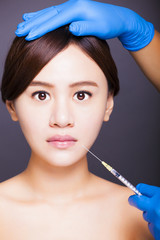 asian beautiful woman gets injection into her mouth. aesthetic m