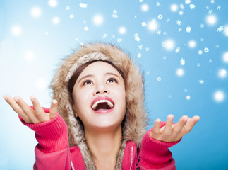 happy young woman watching winter snow