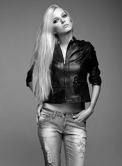 Blonde woman in ragged jeans and jacket