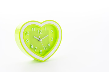 Heart green clock isolated on white background