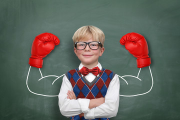 Schoolchild with muscle / Boxing Gloves