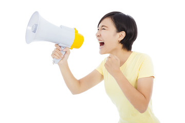 happy young student girl standing and holding megaphone over whi