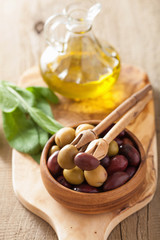 black and green marinated olives oil sage leaf