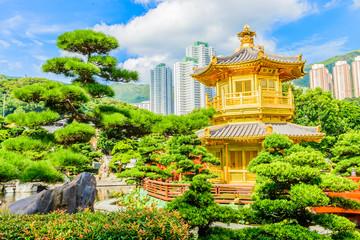 Gold Chinese pavilion at the park of Hong Kong
