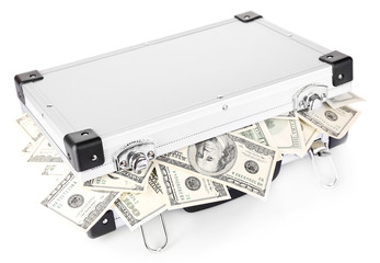 Lot of one hundred dollar bills in suitcase isolated on white