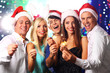 Young people celebrating Christmas in club