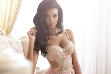 Beauty brunette woman in stylish room