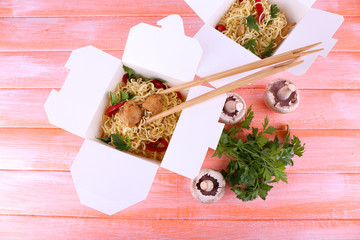 Chinese noodles with meat and pepper in takeaway boxes