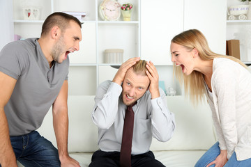 Young couple with problem on reception for family psychologist