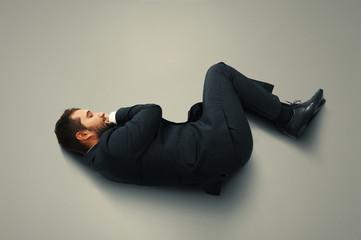 man sleeping on the grey floor