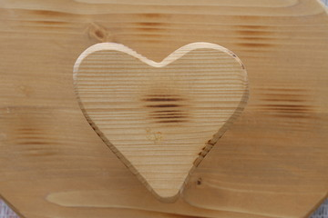 heart symbol inlaid in wood