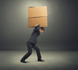 tired young businessman with boxes