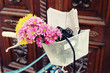 canvas print picture - Old bicycle with flowers in metal basket