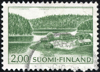 stamp printed by Finland, shows Farm on Lake Shore