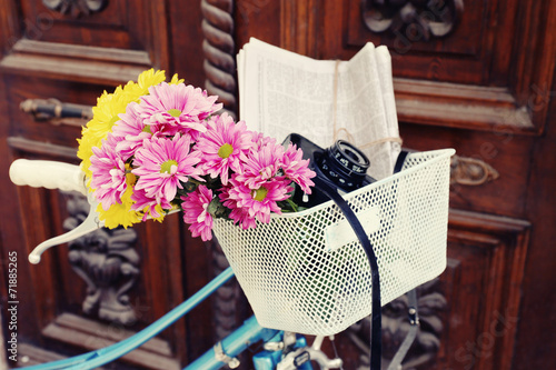 canvas print picture Old bicycle with flowers in metal basket