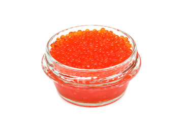 Red caviar in a glass container on a white background
