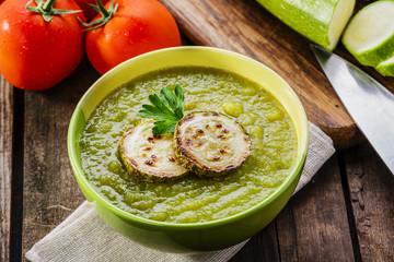 cream zucchini soup into a bowl