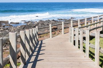 Wood Slat Pole Path Ocean Rocks