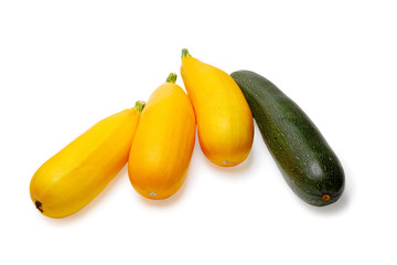 Yellow and green vegetable marrows isolated on a white backgroun