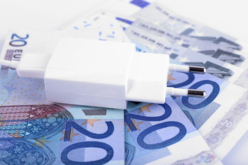 Plug on euro banknotes background