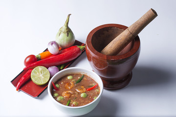 Chili paste with wooden motar