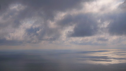 Movement of the clouds over the sea (time-lapse)
