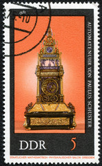 stamp printed in Germany shows collection of ancient clocks