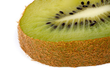 Closeup of slice of kiwi fruit against white background